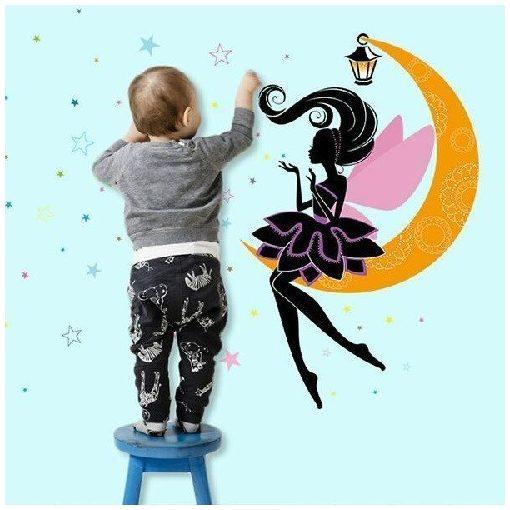 Holdon ülő tündér lámpással, csillagokkal